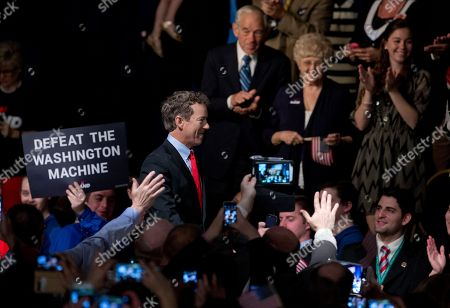Rand Paul, Ron Paul, Carol Paul Sen. Rand Paul, R-Ky. arrives to announce the start of his presidential campaign, at the Galt House Hotel in Louisville, Ky., Tuesday, April 7, 2015. In the background, upper right, are his parents, former Texas Rep. Ron Paul and his wife Carol