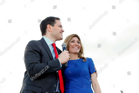 Stock Image of Marco Rubio Republican presidential candidate, Sen. Marco Rubio, R-Fla., hugs his wife, Jeanette, during a campaign rally in Hialeah, Fla