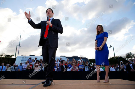 Marco Rubio Republican presidential candidate, Sen. Marco Rubio, R-Fla., speaks as his wife, Jeanette, listens during a campaign rally in Hialeah, Fla