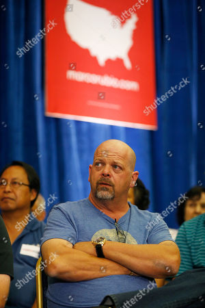 Rick Harrison, who appears on the television show Pawn Stars, listens to Republican presidential candidate, Sen. Marco Rubio, R-Fla., speak at a rally, in Las Vegas