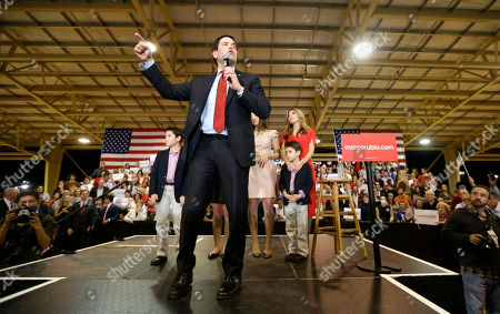 Marco Rubio, Jeanette Rubio Republican presidential candidate, Sen. Marco Rubio, R-Fla., talks to supporters at a campaign rally, in Miami. Accompanying Rubio are his wife, Jeanette, right, and children