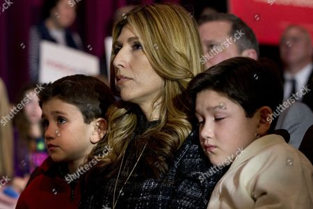 Dominick Rubio, Jeanette Dousdebes, Anthony Rubio Next to brother Anthony Rubio, 10, right, rests against his mother, Jeanette Dousdebes, with brother Dominick Rubio, 8, as their father Republican presidential candidate Sen. Marco Rubio, R-Fla., attends a town hall meeting at Southside Christian School in Simpsonville, S.C