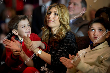 """Dominick Rubio, 8, left, """"helps"""" his mother, Jeanette Dousdebes, to clap for Republican presidential candidate, Sen. Marco Rubio, R-Fla., next to brother Anthony Rubio, 10, as their father speaks during a town hall meeting at Southside Christian School in Simpsonville, S.C"""