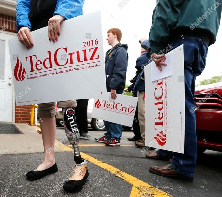 Stock Image of Ted Cruz Laura Mullen, left, from Goshen, Ind., sports a Cruz sticker on her prosthesis as she waits to see Republican presidential candidate, Sen. Ted Cruz, R-Texas, outside the Bravo Cafe during a campaign stop, in Osceola, Ind