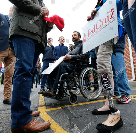 Ted Cruz Laura Mullen, right, from Goshen, Ind., sports a Cruz sticker on her prosthesis as she talks to Republican presidential candidate, Sen. Ted Cruz, R-Texas, outside the Bravo Cafe during a campaign stop, in Osceola, Ind