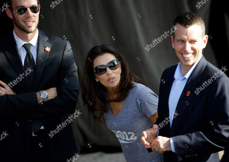 Stock Image of Eva Longoria, David Plouffe, Jon Favreau Actress and Obama supporter Eva Longoria, center, talks with White House Speechwriter Jon Favreau, left, and White House senior adviser David Plouffe, right, during a campaign event at Cheyenne Sports Complex in Las Vegas