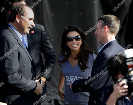 Stock Picture of Eva Longoria, David Plouffe, David Axelrod Actress and Obama supporter Eva Longoria, center, talks with Obama Senior campaign adviser David Axelrod, left, and White House senior adviser David Plouffe, right, during a campaign event at Cheyenne Sports Complex in Las Vegas