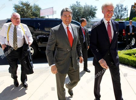 Rick Perry Republican presidential candidate Texas Gov. Rick Perry, center, is met by Frederick J. Ryan, Jr., chairman of the Ronald Reagan President Foundation, as he arrives for a Republican presidential debate at the Reagan Library, in Simi Valley, Calif