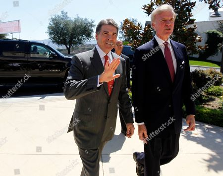 Rick Perry Republican president candidate Texas Gov. Rick Perry, left, is met by Frederick J. Ryan, Jr., chairman of the Ronald Reagan President Foundation, as he arrives for a Republican presidential debate at the Reagan Library, in Simi Valley, Calif