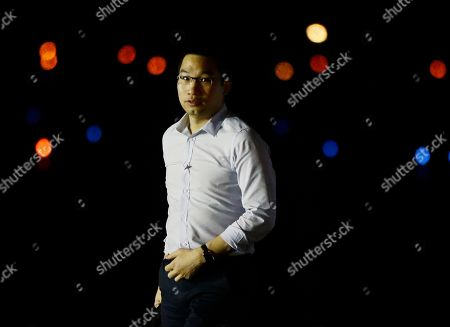 Alex Wong Alex Wong, foreign policy adviser to Republican presidential candidate and former Massachusetts Gov. Mitt Romney, steps off his campaign plane in Weyers Cave, Va