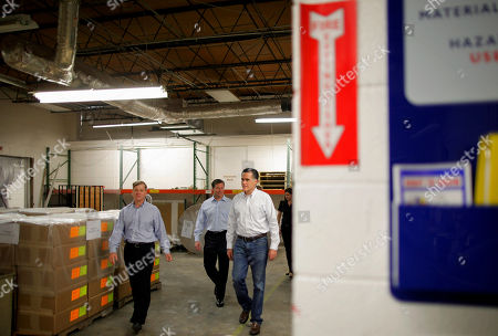Mitt Romney, Jon Cummins, Connie Mack, Mary Bono Mack Republican presidential candidate, former Massachusetts Gov. Mitt Romney, walks with Jon Cummins, president and CEO of Paramount Printing, which is going out of business, in Jacksonville, Fla., . Also at rear are Rep. Connie Mack, R-Fla.; and Rep. Mary Bono Mack, R-Calif