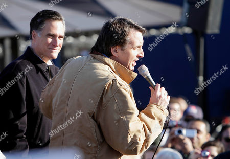 Former Minnesota governor Tim Pawlenty helps Republican presidential candidate, former Massachusetts Gov. Mitt Romney campaign for the New Hampshire primary during a rally with supporters and volunteers, in Manchester, N.H