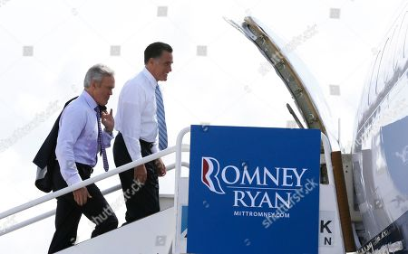 Mitt Romney, Scott Pelley Republican presidential candidate and former Massachusetts Gov. Mitt Romney boards his campaign plane with Scott Pelley of CBS News in Miami