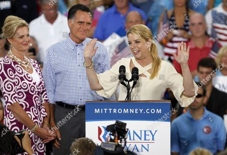 Mitt Romney, Mitt Romney, Pam Bondi Florida attorney general Pam Bondi, right, speaks as Republican presidential candidate and former Massachusetts Gov. Mitt Romney, center, and his wife Ann, left, look on during a campaign rally, in Port St. Lucie, Fla