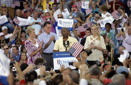Mitt Romney, Ann Romney, Allen West, Pam Bondi U.S. Rep. Allen West, R-Fla., center, speaks as he stands at the podium withRepublican presidential candidate and former Massachusetts Gov. Mitt Romney, second from left, and his wife Ann, left, during a campaign rally, in Port St. Lucie, Fla. At right is Florida attorney general Pam Bondi