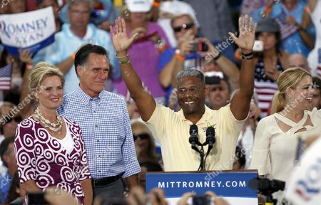 Mitt Romney, Allen West, Pam Bondi, Ann Romney U.S. Rep. Allen West, R-Fla., center, waves before introducing Republican presidential candidate and former Massachusetts Gov. Mitt Romney, second from left, and his wife Ann, left, during a campaign rally, in Port St. Lucie, Fla. At right is Florida attorney general Pam Bondi