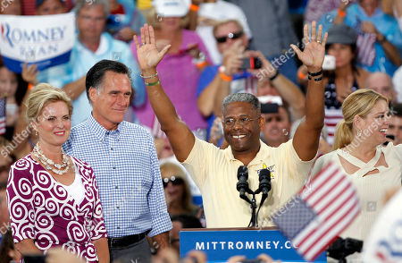 Mitt Romney, Ann Romney, Allen West, Pam Bondi U.S. Rep. Allen West, R-Fla., center, waves before introducing Republican presidential candidate and former Massachusetts Gov. Mitt Romney, second from left, and his wife Ann, left, during a campaign rally, in Port St. Lucie, Fla. At right is Florida attorney general Pam Bondi