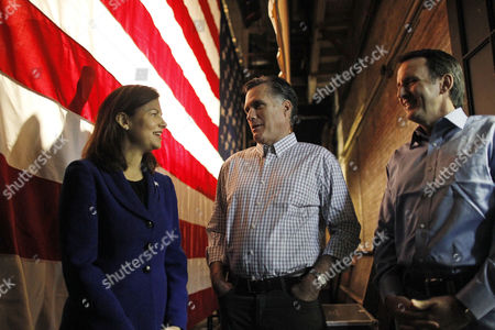Mitt Romney, Kelly Ayotte, Tim Pawlenty Republican presidential candidate, former Massachusetts Gov. Mitt Romney, center, talks with Sen. Kelly Ayotte, R-N.H., left, and former Minnesota Gov. Tim Pawlenty backstage before the start of a campaign event at the Rochester Opera House in Rochester, N.H