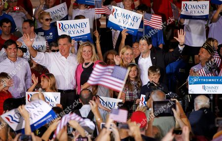 """Mitt Romney, Paul Ryan, Ann Romney, Janna Ryan Republican presidential candidate, former Massachusetts Gov. Mitt Romney, with his wife Ann, and his newly announced vice presidential running mate, Rep. Paul Ryan, R-Wis., far right, and his wife, Janna, during a campaign rally in Manassas, Va. The Romneys envision a White House enlivened by """"little feet in the hallway"""", 18 visiting grandkids and they are dishing out personal details as they try to warm up a candidate burdened by a cold-fish image. America may not be ready for this one: Instead of syrup, Mitt Romney slathers his pancakes with peanut butter"""