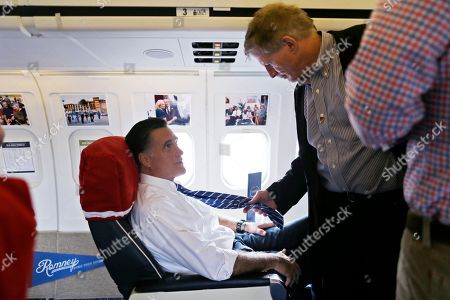Mitt Romney, Stuart Stevens Chief strategist Stuart Stevens, right, examines the necktie of Republican presidential candidate and former Massachusetts Gov. Mitt Romney after they boarded his campaign plane at Tampa International Jet Center, in Tampa, Fla., . Romney was traveling to Ohio for campaign events with his vice presidential running mate Rep. Paul Ryan, R-Wis