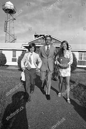 Democratic vice presidential candidate R. Sargent Shriver leaves Otis Air Force Base to board special charter plane for campaign trip to West Virginia and California on in Falmouth, Mass. Two of his children, Timothy and Maria, were making the trip with him