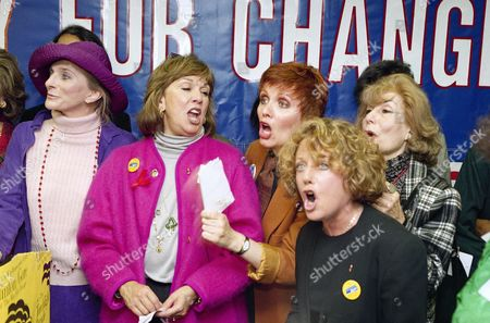 Women, gathered to help announce a torchlight parade rally supporting Democratic presidential candidate Bill Clinton, sing a campaign song to climax the event in New York, . From left are performers Judy Collins, Phyllis Newman, Maureen McGovern, Leslie Gore and Betty Comden. They plan a women's torchlight parade down Fifth Avenue for a rally in Washington Square October 28