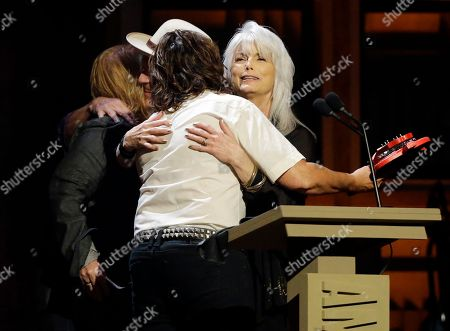 Emmylou Harris, right, and Rodney Crowell, second from left, accept their awards for group/duo of the year