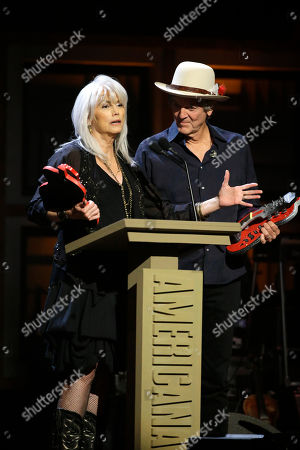 Emmylou Harris, left, and Rodney Crowell accept their awards for group/duo of the year