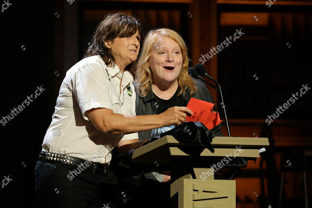 Amy Ray, left, and Emily Saliers of the Indigo Girls, present an award