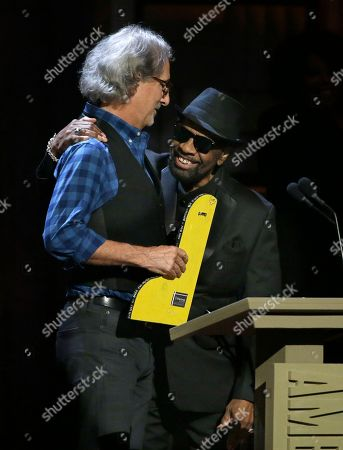 John Leventhal, left, presents William Bell the lifetime achievement award for songwriting