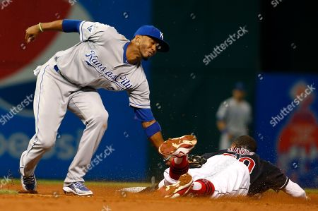Alcides Escobar, Rajai Davis Kansas City Royals' Alcides Escobar, left, tags out Cleveland Indians' Rajai Davis, attempting to steal second base during the sixth inning of a baseball game, in Cleveland