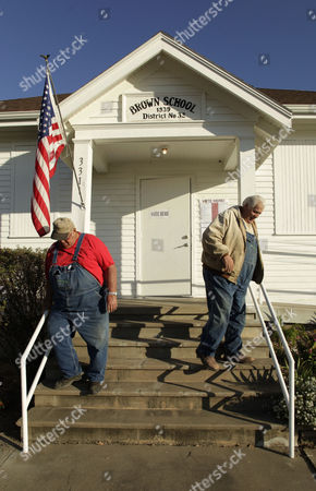 Brothers Larry, left, and Roger Ferguson, both of Ottawa, Kan, leave the Hayes Township Hall in rural Franklin County, Kan, after casting their votes in the general election
