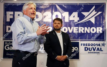 Fred DuVal, Ruben Gallego Democratic candidate for Arizona governor Fred DuVal, left, talks to supporters as Democratic candidate for U.S. Congress in the 7th Congressional District in Arizona, Ruben Gallego, right, looks on during a final day campaign push, in Phoenix. DuVal is running against Republican Doug Ducey in the election to replace retiring Republican Gov. Jan Brewer