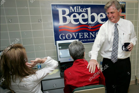 Stock Image of Mike Beebe Arkansas Gov. Mike Beebe, right, greets campaign workers Audrey Kelley, left, and Jean Ann Bell at his Little Rock, Ark., campaign headquarters. While Democrats and incumbents are on the defensive across the nation this election year, Arkansas Gov. Mike Beebe finds himself in an unusual position. He's both a Democrat and an incumbent and serving in a state where his party's national agenda is especially unpopular, yet he has remained blissfully untouched by the angry climate. Meanwhile, those woes have turned his Arkansas colleague, Sen. Blanche Lincoln, into one of the most endangered incumbents on the ballot this fall