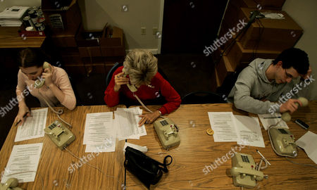 BUSH HEADQUARTERS Volunteers Stacy Birrell, left, Jan Held and Corey Clark call registered voters from the Ohio campaign headquarters for President George W. Bush in Columbus, Ohio on . Ohio remains a key battleground state in the presidential election