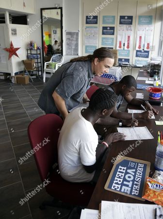 Matt Sagorski, Blake West, Dehjahn Swain Volunteer Matt Sagorski, left, helps Blake West, 20, center, and Dehjahn Swain, 19, right, register to vote at a campaign office for President Barack Obama, in Miami. Tuesday is the last day to register to vote in the general election Nov. 6