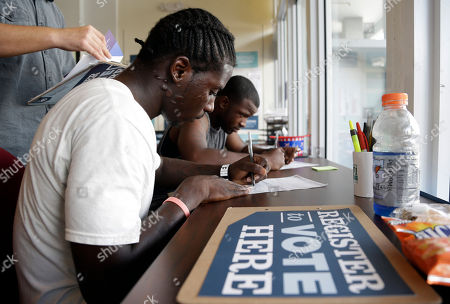 Blake West, Dehjahn Swain Blake West, 20, left, and Dehjahn Swain, 19, right, register to vote at a campaign office for President Barack Obama, in Miami. Tuesday is the last day to register to vote in the general election Nov. 6