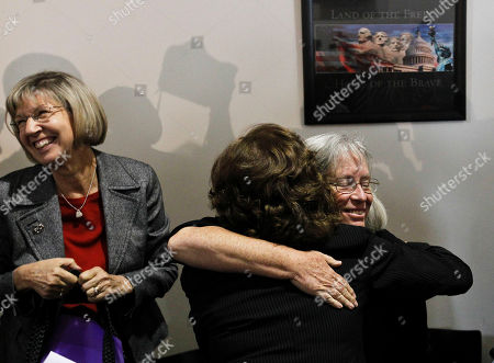 Pam Simon, Barbara LaWall, Emily Nottingham Emily Nottingham, right facing, and mother of shooting victim Gabe Zimmerman, gets a hug from Pima County Attorney Barbara LaWall, as shooting victim Pam Simon, left, smiles at a news conference after the sentencing of Jared Loughner, at U.S. District Court, in Tucson, Ariz. U.S. District Judge Larry Burns sentenced 24-year-old Jared Lee Loughner on Thursday for the January 2011 attack that left six people dead and Giffords and others wounded