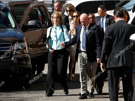 Stock Picture of Gabrielle Giffords, Mark Kelly Former Democratic Rep. Gabrielle Giffords, left, and her husband Mark Kelly leave after the sentencing of Jared Loughner, in back of U.S. District Court, in Tucson, Ariz. U.S. District Judge Larry Burns sentenced Jared Lee Loughner, 24, to life in prison, for the January 2011 attack that left six people dead and Giffords and others wounded. Loughner pleaded guilty to federal charges under an agreement that guarantees he will spend the rest of his life in prison without the possibility of parole