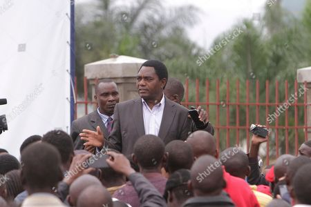Presidential candidate Hakainde Hichilema addresses his supporters after they demonstrated outside the presidential election results center, a day after elections in Lusaka, Zambia Wednesday, Jan, 21, 2015. Candidates vying to replace Zambia's late President Michael Sata have cast their ballots along with thousands of other voters in Tuesday's presidential election