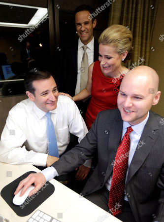 Ted Heidi Cruz, Scott Nelson, Jasonb Johnson Republican candidate for U.S. Senate Ted Cruz, bottom left, smiles as he goes over election results with his wife Heidi, back right, her brother Scott Nelson, back left, and campaign chief consultant Jason Johnson, bottom right, in Houston. Cruz is running against Democrat Paul Sadler to replace retiring U.S. Sen. Kay Bailey Hutchison
