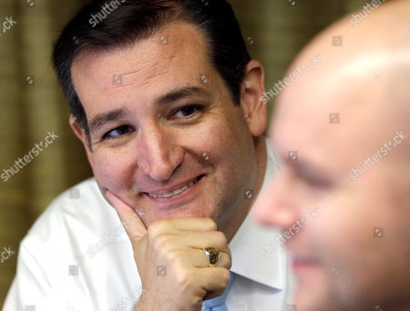 Ted Cruz, Jason Johnson Republican candidate for U.S. Senate Ted Cruz, left, smiles as he listens to campaign chief consultant Jason Johnson go over election results as they come in, in Houston. Cruz is running against Democrat Paul Sadler to replace retiring U.S. Sen. Kay Bailey Hutchison