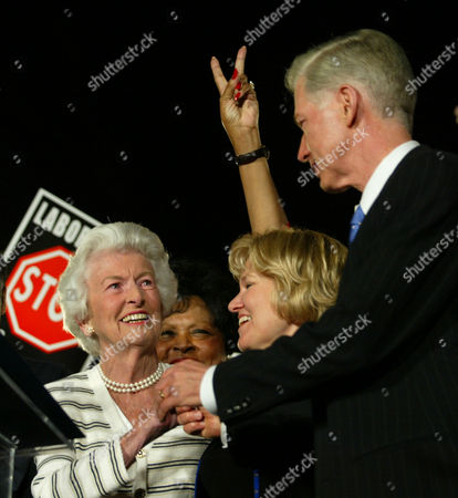 DAVIS MORRELL WATSON California Gov. Gray Davis, right, reaches for his mother Doris Morrell, left, as his wife Sharon looks before he was introduced to the stage during the get out the vote rally, on the eve of the California recall election. Making a victory sign is Congresswoman is Diane Watson, D-Calif