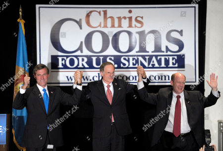 Chris Coons, Tom Carper, John Carney Jr Sen. Tom Carper, D-Del., center, celebrates with the two newest members of the Delaware Congressional delegation, Rep.-elect John Carney, Jr., D-Del., left, and Sen.-elect Chris Coon, D-Del., right, during a Democratic election night rally in Wilmington, Del