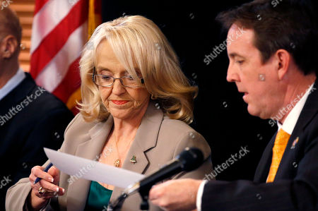 Jan Brewer, Ken Bennett Secretary of State Ken Bennett, right, gets back the certification signature of the official election results canvass from the Nov. 4 general election by Gov. Jan Brewer, left, who along with Bennett and others signed the documents at the Arizona Capitol, in Phoenix