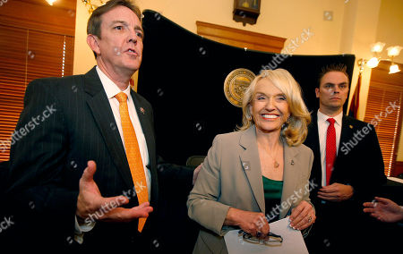 Jan Brewer, Ken Bennett Secretary of State Ken Bennett, left, and Gov. Jan Brewer, center, talks about the election canvass certification for the results of the Nov. 4 general election after a signing ceremony at the Arizona Capitol, in Phoenix