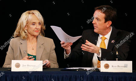 Jan Brewer, Ken Bennett Secretary of State Ken Bennett, right, hands over the official election results canvass from the Nov. 4 general election to be signed for certification by Gov. Jan Brewer, left, along with Bennett and others at the Arizona Capitol, in Phoenix