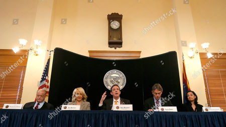 Jan Brewer, Ken Bennett, Tom Horne, Scott Bales, Christina Estes-Werther From left to right, Arizona Attorney General Tom Horne, Arizona Gov. Jan Brewer, Arizona Secretary of State Ken Bennett, Arizona Supreme Court Chief Justice Scott Bales, and Arizona State Elections Director Christina Estes-Werther take part in a certification signing ceremony for results of the Nov. 4 general election as Bennett answers a specific question about the provisional election ballots at the Arizona Capitol, in Phoenix
