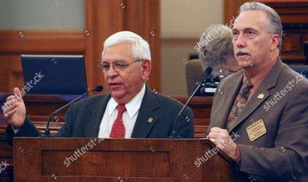 Kansas state Rep. John Rubin, left, a Shawnee Republican, answers questions from Rep. Tom Burroughs, right, a Kansas City Democrat, during a debate on election fraud legislation, at the Statehouse in Topeka, Kan. Rubin supports the bill, which would require voters to show photo identification at the polls, while Burroughs opposes it