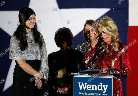 Stock Image of Wendy Davis, Election Texas Democratic gubernatorial candidate Wendy Davis, right, reacts as she makes her concession speech at her election watch party, in Fort Worth, Texas. Davis' daughter Dru, left, mother Ginger Russell, and sister Jennifer James, right rear, watch during the speech